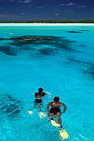 Couple snorkeling in a lagoon