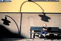 Boy playing on bench