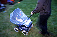 Father pulling baby carriage