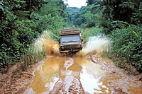 Car going through a mud hole. Democratic Republic of the Congo (former Zaire)