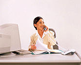 Asian executive woman talking on phone