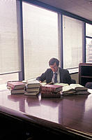 Lawyer in office with books on desk