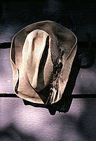 Hat and horseshoes on wall