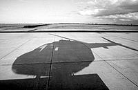 Helicopter shadow on airport runway