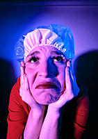 Saddened woman with shower cap