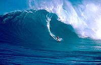 Surfing  'Jaws', a 30' wave on the north shore of Maui, Hawaii