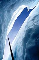 Climbing rope descends into crevasse in Easton Glacier. Mount Baker Wilderness. Washington. USA