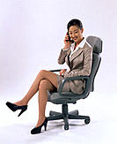 Asian executive woman talking on cell phone