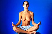 Nude woman doing yoga