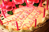 Close up, top view of a birthday cake with candles
