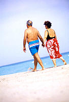 Mature couple walking at the beach, Florida, USA