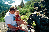 Grandfather and grandson on a hike enjoying the view and a brief rest