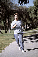 Mature woman jogging outdoor, Florida