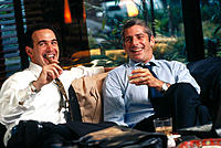 Businessmen having drink and cigar in a hotel lounge