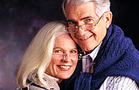 Close mature couple wearing glasses