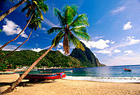 Boats on the beach and Petit Piton mountain in background. St. Lucia (West Indies)