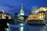 Fountain at Trafalgar Square, Saint Martin in the Fields church in background. London. England