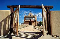 Adobe church and gate. San Ildefonso Pueblo. New Mexico. USA