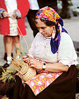 Woman in traditional costume at wickerwork handicrafts. Madeira Islands. Portugal