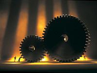 Miniature workman pushing gears