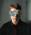 Man Wearing Blindfold Printed with Map of the World