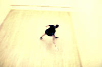 Blurry overview of person playing squash