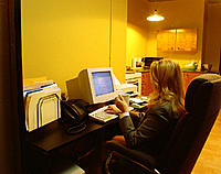 Home office woman drinks coffee while using computer, series