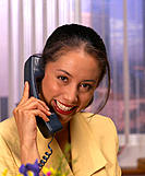 Polynesian looking business woman holding telephone B1139