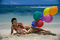 Mother & Daughter at the beach playing, colorful balloons B1035