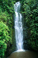 Maui, Hana, Wailua Valley, Woman @ bottom of waterfall under rushing water C1648