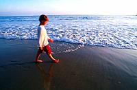 Boy walking on beach