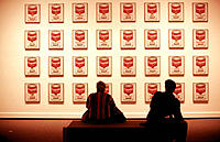 Two people looking at Campbell's Soup cans. National Gallery of Art, East Building. Washington D.C