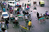Cycle-cabs at crossroads in the old city. Delhi. India