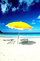 Two lounge chairs under a beach umbrella on the beach, Friar´s Bay, St  Martin