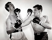 Two mid adult men boxing