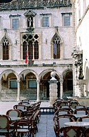 Facade of Sponza Palace built in 1516 and outdoor café at fore on the Stradun (Main Street). Dubrovnik. Croatia