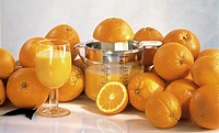 Fresh Oranges and Glass of Orange Juice