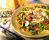 Ribbon noodles with spinach, Roquefort, tomatoes & pignoli nuts