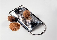 Nutmegs whole and grated, with grater