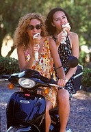 Two Sicilian women with ice cream on a moped