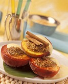 Baked peaches with brown sugar, cinnamon and vanilla sauce