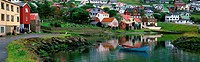 Village of Eidi with rowboat, Faroe Islands