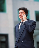 Business Man Outdoors with Cell Phone