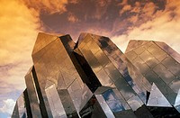 Filtered photograph of the reflective glass structure of one of the buildings at Futuroscope, a science-based theme park at Poitiers, France. This bui...
