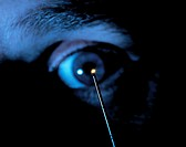 Micro-endoscope held up to an eye. This micro- endoscope can be used to look for the first signs of breast cancer. The ultra-fine endoscope incorporat...