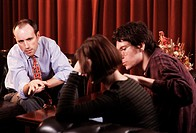 Counselling. Woman being comforted by her partner while they are counselled by a man. Counselling is the provision of advice and psychological or psyc...