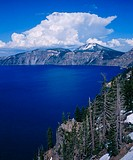Cumulus clouds rise over lake. Crater Lake National Park. Oregon. USA