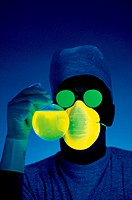 Photo illustrated from a man auditioning radiation, masks, glasses, rings, gloves.