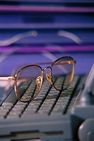 Eyeglasses on laptop computer