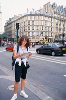 Female tourist looking at map. Paris. France